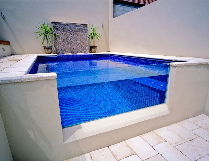 Creating An Oasis In A Sloped Backyard Blue Haven Pools