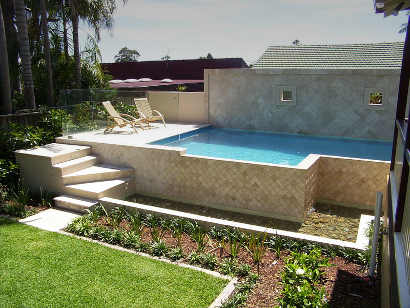 Semi inground swimming pool blue haven pools for Best semi inground swimming pools