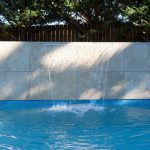 Lan Cove Concrete Pool with waterfall feature