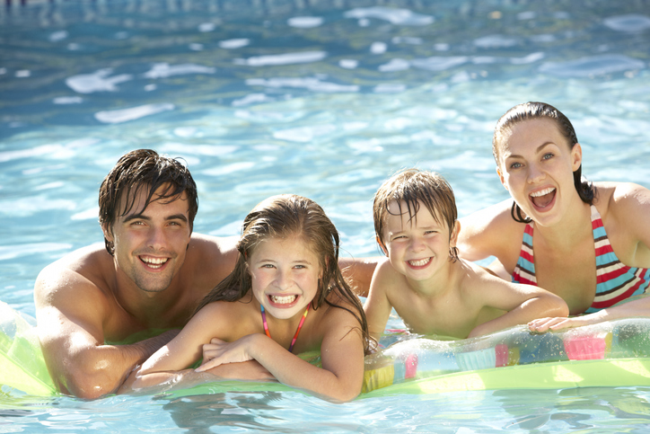 Parents are swimming with kids in the pool