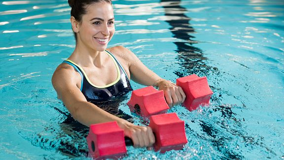Doing aerobics exercise in the swimming pool